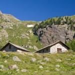 Постер, плакат: Alpine stone houses