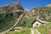 Stone houses in alps — Stock Photo