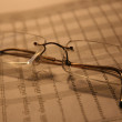 Eyeglasses on finance sheet — Stock Photo