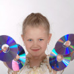 The girl holds CD — Stock Photo #1364230
