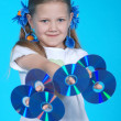 The girl holds 6 CD — Stock Photo #1364345