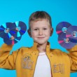 The boy holds 6 CD — Stock Photo