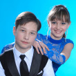 Boy and girl posing in studio — Stock Photo