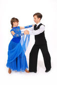 Boy and girl dancing ballroom dance — Stock Photo