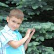 The boy holds in hands blue spruce — Stock Photo #1420386