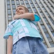 Young boy in a big city — Stock Photo