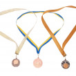 Three bronze medals on white background — Stock Photo #1425923