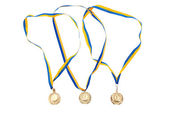 Gold medals isolated on white background — Stock Photo