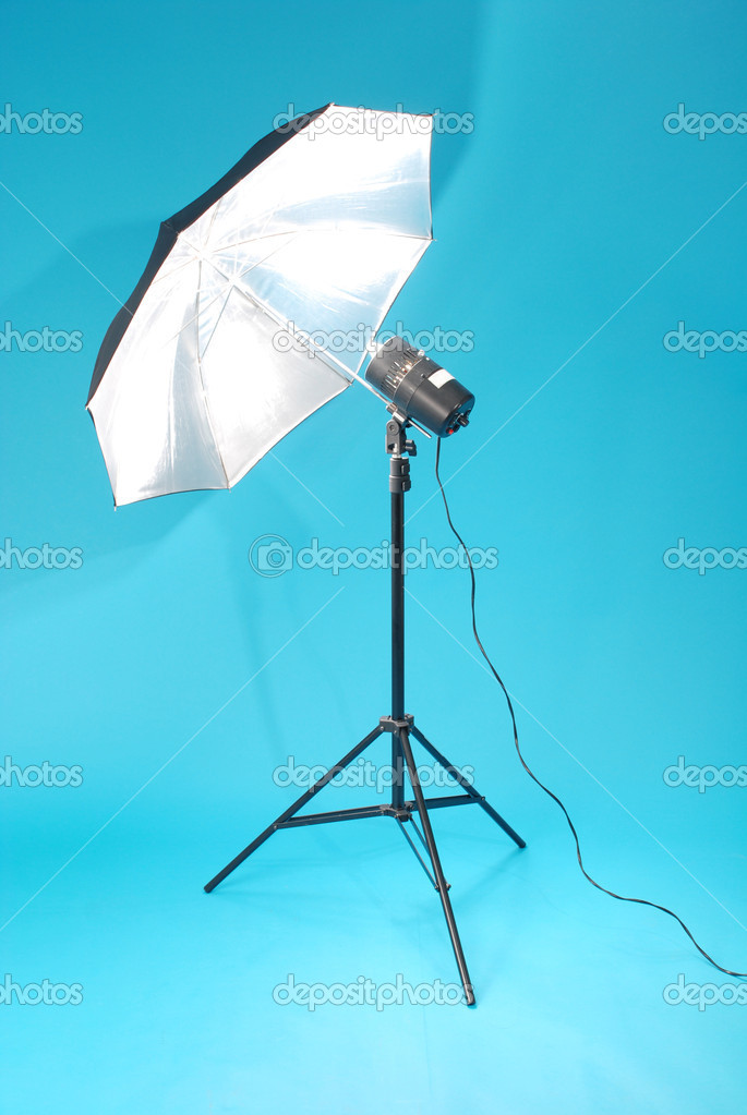 Studio strobe isolated on the blue background  Stock Photo #1421985