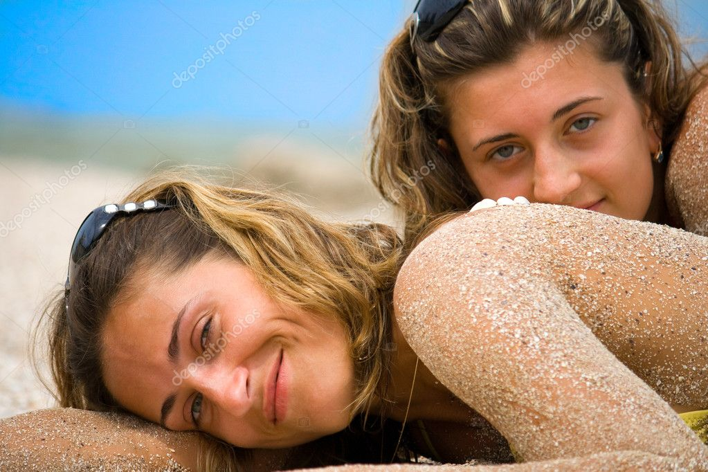 Young girls, sunbathing by the sea — Stock Photo #1361775