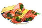 Beautiful sliced food arrangement in blue plate — Stock Photo