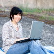 Royalty-Free Stock Photo: Woman working on laptop outdoor