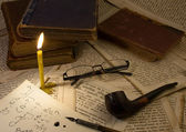 Pipe Smoking,candle, Glasses, old books — Zdjęcie stockowe