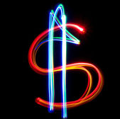 Neon dollar on the black background — Stock Photo