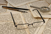 Glasses, pencil, ink pen, lens — Stock Photo