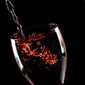 Glass of wine on a black background — Stock Photo