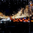 Blurred lights for wet window — Stock Photo #1509789