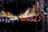 Blurred lights for wet window — Stock Photo