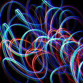Chaotic colorful lights on a black background — Stock Photo
