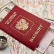 Passport  with money on a map,compass - Foto Stock
