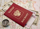 Passport with money on a map,compass — Stock Photo