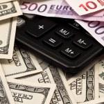 Dollars, euro and calculator — Stock Photo