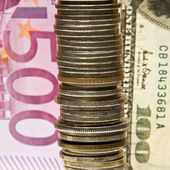 Coins on the background euro, dollar. — Stock Photo