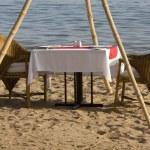 Dinner table on the beach — Stock Photo #1366060
