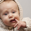 Royalty-Free Stock Photo: Baby out a finger to a mouth