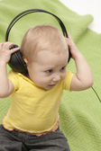 Baby and headphones — Stock Photo