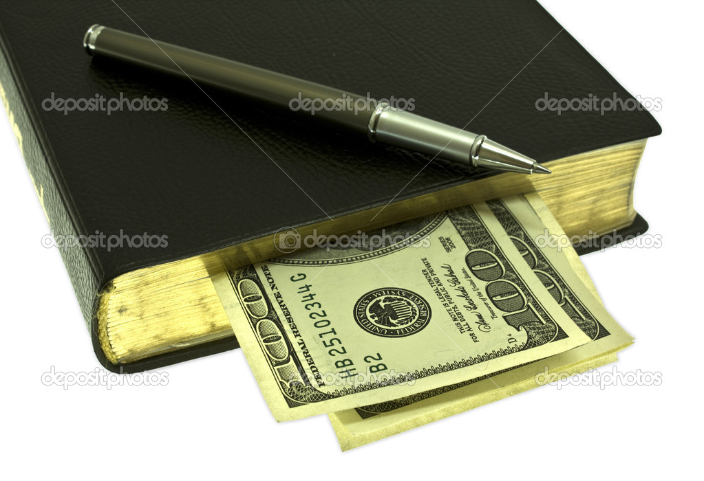 Dollars are in books with a pen, isolated on a white background, business teaching. — Stock Photo #1404847