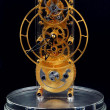 Stock Photo: Gold mechanical clock