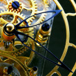 Foto de Stock  : Mechanism of a gold clock