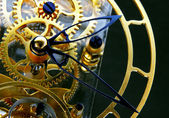 Mechanism of a gold clock — Stock Photo