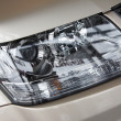 Foto Stock: Headlight on beige car