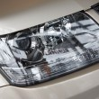 Stock Photo: Headlight on beige car