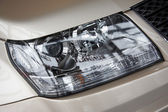 Headlight on a beige car — 图库照片