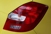 Lanterns of the yellow modern car — Stock Photo