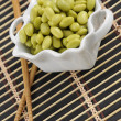 soybeans in a white dish with chopsticks — Stock Photo