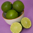 Fresh Limes on a Purple Background — Foto Stock