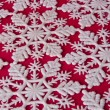 Snowflake Background on Red — Stock Photo #1384389
