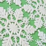Snowflake Background on Green — Stock Photo