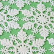 Snowflake Background on Green — ストック写真