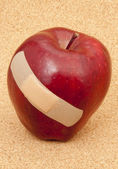 Apple with Bandaid — Stockfoto