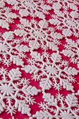 Sfondo di fiocco di neve su rosso — Foto Stock