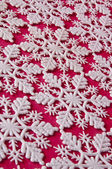 Snowflake Background on Red — 图库照片