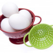 Red and Green Colanders with Fresh Eggs - Stock Photo