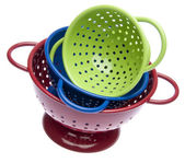 Stack of Bright Colanders — Stock Photo