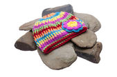 Brightly Colored Hat on River Rocks — Stock Photo
