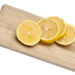 Fresh Cut Lemons on Cutting Board — Stock Photo